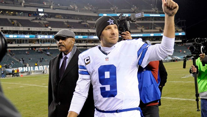 Dec 14, 2014; Philadelphia, PA, USA; Dallas Cowboys quarterback Tony Romo (9) walks off the field with the Sunday Night Football Game Ball after win over the Philadelphia Eagles at Lincoln Financial Field. The Cowboys defeated the Eagles, 38-27. Mandatory Credit: Eric Hartline-USA TODAY Sports
