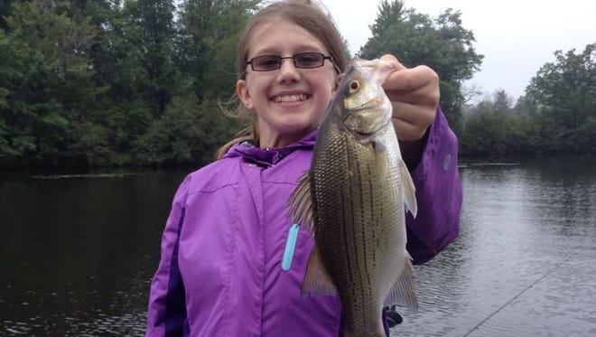 Annie Tufto with a white bass caught in September 2014 with guide Phil Schweik.