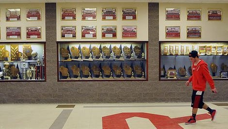 The dynasty of Wisconsin Rapids wrestling team is symbolized by the trophy case in the hallway near the Lincoln High School field house.
