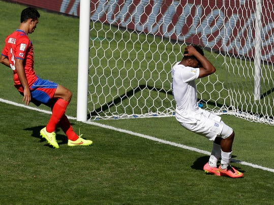 England's Daniel Sturridge reacts during the group D World Cup soccer match between Costa Rica and England at the Mineirao Stadium in Belo Horizonte, Brazil, Tuesday, June 24, 2014. (AP Photo/Michael Sohn)