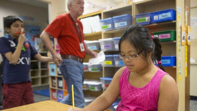 Aubrey Macolor, 12, does work in an Extended Resource class at Kyrene Aprende Middle School.