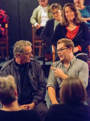 """In """"Every Brilliant Thing,"""" Dan Klarer (right) interacts continually with members of the audience."""
