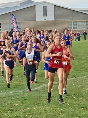 Coldwater's Legend Szafranski leads a large pack of runners Saturday at Lake Odessa. Szafranski ended up taking 3rd place overall.