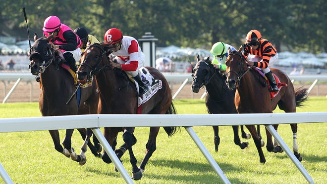 Big Blue Kitten, right, with Joe Bravo aboard, wins the Grade 1 United Nations Stakes at Monmouth Park in Oceanport, N.J. in July.