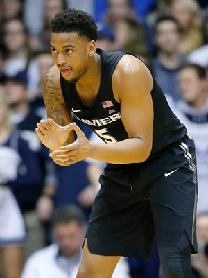 Xavier Musketeers guard Trevon Bluiett (5) claps as he gets back on defense after scoring three in the first half of the NCAA Big East Conference basketball game between the Butler Bulldogs and the Xavier Musketeers at Hinkle Fieldhouse in Indianapolis on Tuesday, Feb. 6, 2018. Xavier led 40-30 at halftime.