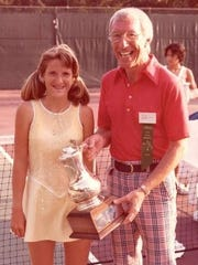 Tracy Austin, left, is presented with a championship