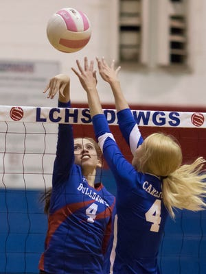 Las Cruces High's Christina Aguayo hits one over Carlsbad's Baylee Lynn in the first round of the District 3-6A tournament Monday night at Las Cruces High School.