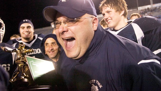 Ron Miller celebrates after the Bulldogs defeated Manheim Central, 15-7, Friday to win the District 3 Class AAA title in 2008.