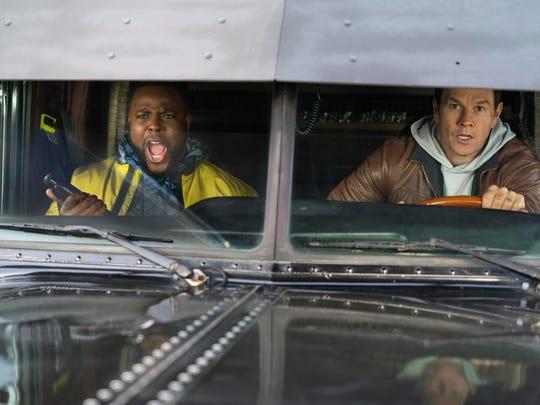 "Mark Wahlberg, right, and Winston Duke in a scene from ""Spenser Confidential."""