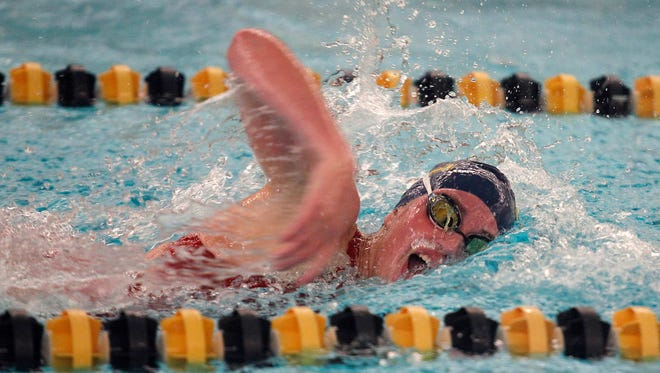 Grand Ledge's Lola Mull competes in the 500 freestyle crescendo relay at the Waverly Relays, Wednesday, Aug. 23, 2017, at Waverly High School.