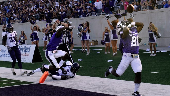 Abilene Christian University running back De'Andre Brown reacts after he was knocked out of bounds just shy of scoring a touchdown against Stephen F. Austin University Saturday Sept 23, 2017. ACU lost, 10-20.