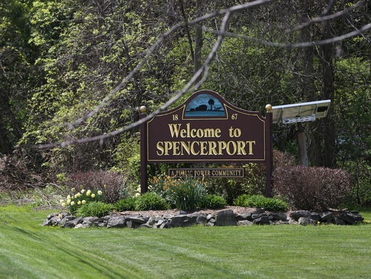 "A ""Welcome to Spencerport"" sign on North Union Street."