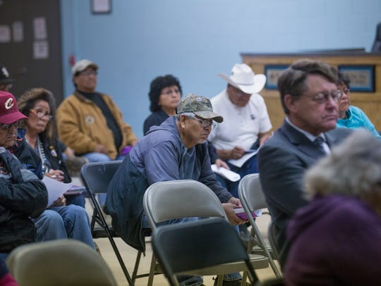 Community members listen to a seminar on funeral-related issues on Thursday at the Shiprock Chapter house.