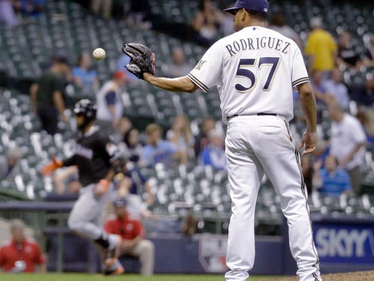 Milwaukee Brewers relief pitcher Francisco Rodriguez gets a new ball after giving up a home run to Miami Marlins' Marcell Ozuna during the ninth inning of a baseball game Tuesday, Sept. 9, 2014, in Milwaukee. (AP Photo/Morry Gash)