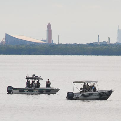 Authorities search the Indian River just south of State