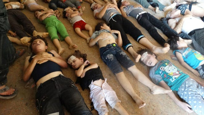 Victims of an attack on Ghouta, Syria, on Wednesday.