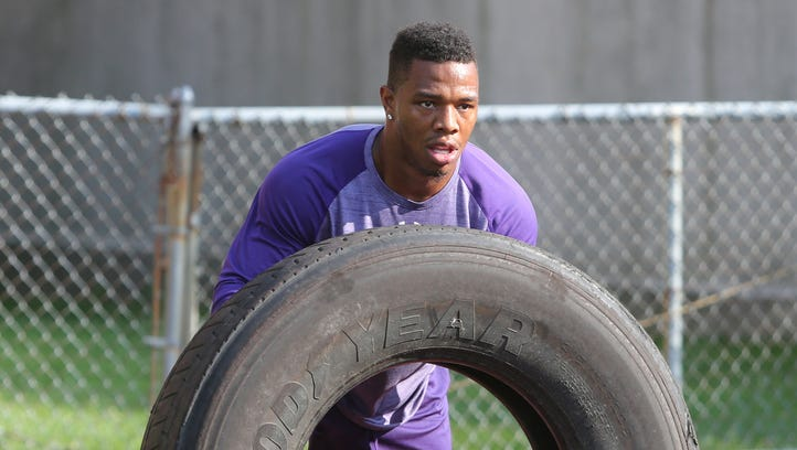 Former Baltimore Ravens running back Ray Rice moves a heavy tire as he works out with New Rochelle High School football players at his alma mater in New York, July 20, 2016.