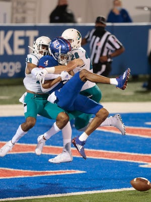 Kansas senior wide receiver Andrew Parchment is tackled by Coastal Carolina defenders in the second half of Saturday's matchup at David Booth Kansas Memorial Stadium. The Jayhawks lost 38-23.