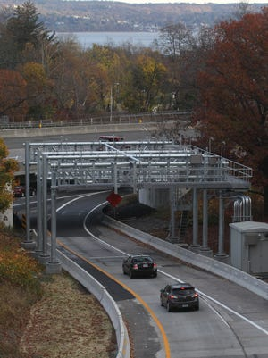 Cars travel under an electronic toll gantry on the entrance ramp to the state Thruway in South Nyack. Tolls are collected automatically from it.