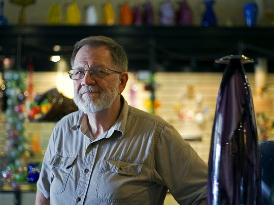 Terry Bloodworth of Springfield Hot Glass poses in his shop, which is located in the Downtown Springfield Community Improvement District, in Springfield, Mo. on June 23, 2015. Bloodworth said the CID has been a benefit for his business and others.