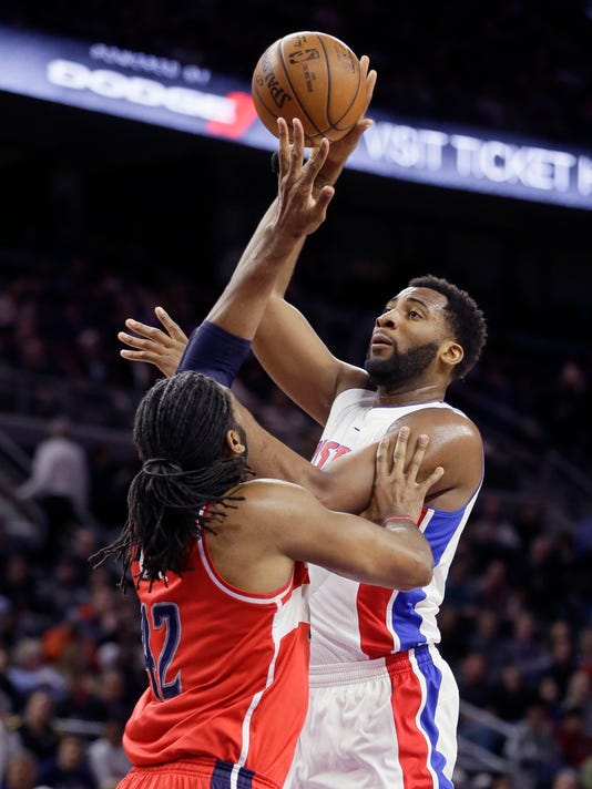 Detroit Pistons center Andre Drummond shoots over Washington Wizards center Nene during the first half of an NBA basketball game Friday, April 8, 2016, in Auburn Hills, Mich. (AP Photo/Carlos Osorio)