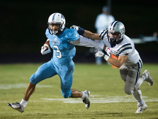 Hardin Valley's Aaron Dykes is pursued by Farragut's Alex Williams at Hardin Valley Academy on Thursday, October 26, 2017.