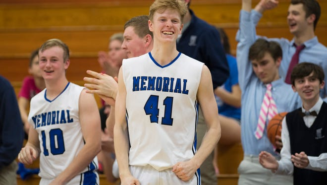 Memorial's Sam Devault (41) and Michael Lindauer (10) celebrate a made shot against North in the 2017-18 season.