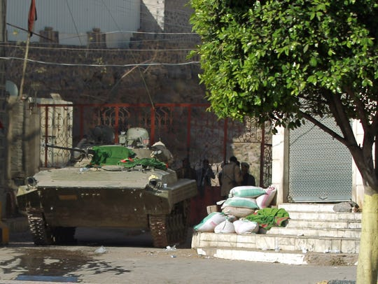 A tank is positioned next to the home of Yemeni President