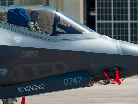 An F-35 is moved as students get a sneak peek at the