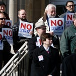 About two dozen business leaders and employees rallied on the steps of City Hall on Thursday to support Springfield's expanded nondiscrimination ordinance.