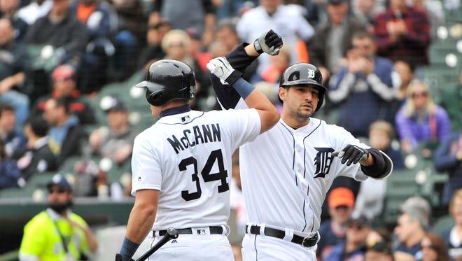 Tigers' James McCann congratulates Nick Castellanos after he hits a home run earlier this season.