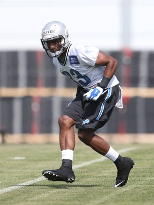 Cornerback Alex Carter goes through drills during the Detroit Lions rookie minicamp at the Allen Park practice facility on May 8, 2015.