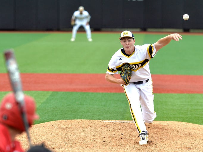 Michigan's Evan Hill pitches in to the Bradley side