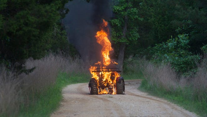 Don Wooten of Henderson escaped injury Friday evening when his ATV caught fire on a gravel road near Hand Cove Road.