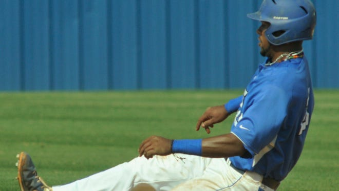 Faulkner University's Sergio Sanchez (21) begins his slide to second base during their game with MidAmerica Nazarene University in the NAIA Opening Round Tournament at Faulkner in Montgomery, Ala., on Tuesday, May 13, 2014.