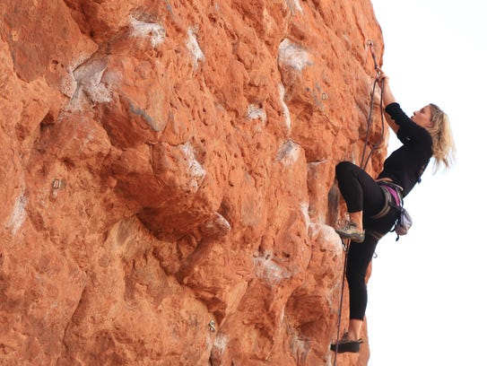 Malynda Madsen ascends the Chuckwalla Wall in St. George,