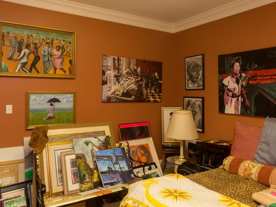 Stacks of art in a guest room.