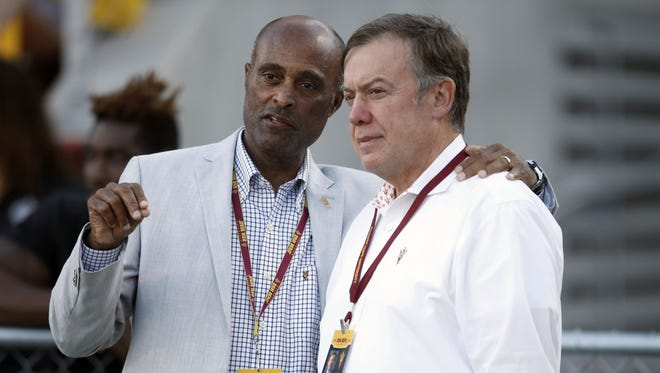 Ray Anderson, ASU Vice President for University Athletics and AD, and Michael Crow, ASU President, watch the Territorial Cup game against Arizona at Sun Devil Stadium in Tempe on November 21, 2015.
