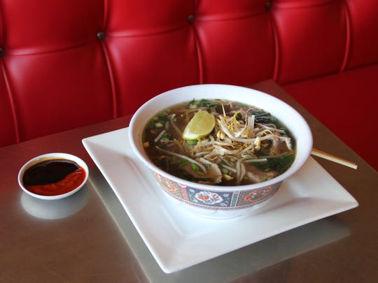 Pho at Wild Pear Restaurant & Catering starts with roasted marrow bones and ends with a few shakes of fish sauce. Owners Jessica Ritter and Cecilia Ritter James serve their pho in the style of Saigon, with a dish of sriracha and hoisin to add.