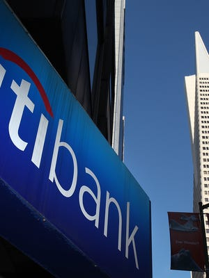 File photo taken n 2011 shows a Citibank sign outside a branch office in San Francisco.