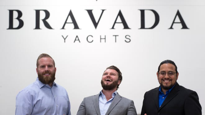 CEO Aaron Browning (from left), President Andrew Marshall and COO Robert Gutierrez Feb. 5, 2018, at the Bravada Yachts manufacturing facility in Tolleson.