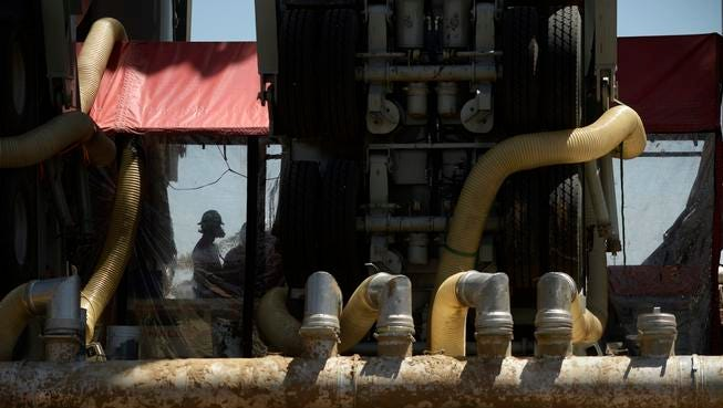 BRIGHTON, CO - MAY 19: A fracking crew member works inside the Halliburton Sandcastle, at an Anadarko Petroleum Corporation site, near Brighton, May 19, 2014. Oil and gas operations are booming in northern Colorado.