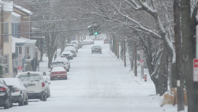 Snowfall pictured on Mill Street.