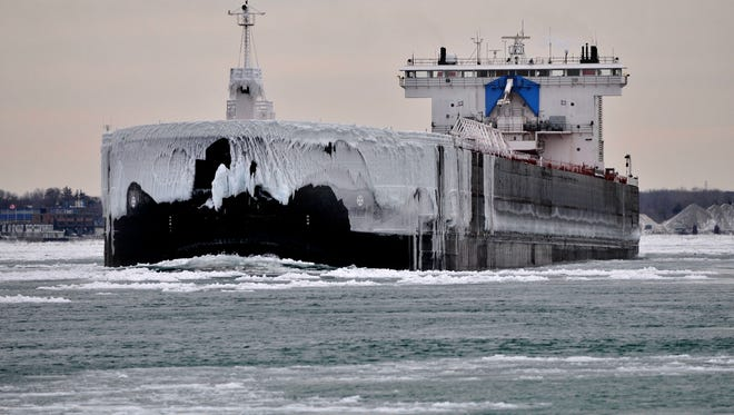 The ice-covered Walter J. McCarthy Jr. travels up the St. Clair River into Lake Huron Thursday, Jan. 8, on its way to Lake Superior for a load of coal after unloading in St. Clair. The U.S. Coast Guard started the ice breaking Thursday.