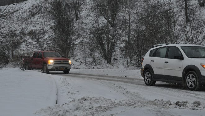 Vehicles travel outside the Ametek Aerospace office in Choconut Center on Monday morning.