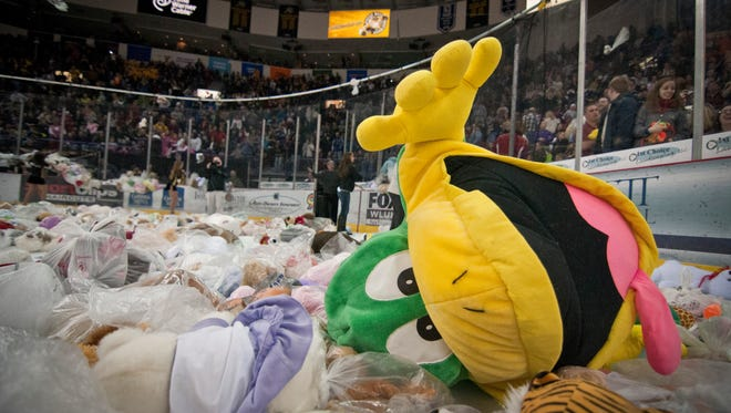 A  stuffed frog rests among other stuffed animals Saturday after the 2013 Gamblers teddy bear toss at the Resch Center in Ashwaubenon.