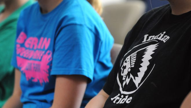 """A member of audience shows her support to Berlin High School by wearing a school T-shirt with an Indian head logo and """"Indian Pride"""" at the hearing of Berlin High School's use of Indian mascot Wednesday, August 3, 2011 in the Wisconsin Department of Public Instruction building in Madison.  The DPI will make a decision on whether Berlin High will be able to keep its Indians nickname within 45 days of the hearing.  Oshkosh Northwestern Photo by Shu-Ling Zhou"""
