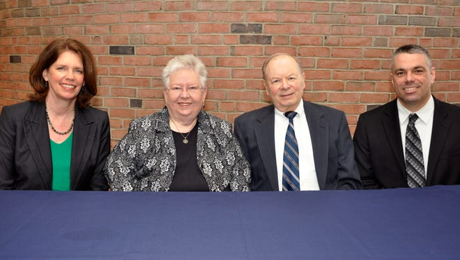 (From left) Dr. Laura Koehl of Notre Dame Academy, Ginnie and Joe Schmidt, and Bob Rowe of Covington Catholic.