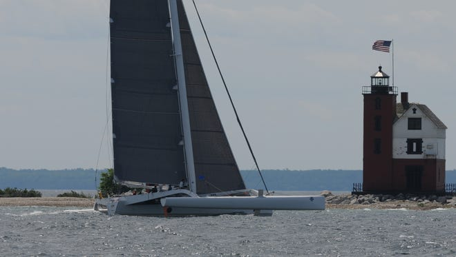 Rick Warner's Arete' crosses the finish line Sunday at Mackinac Island. It was the first boat to the finish in the Port Huron-to-Mackinac Island sailboat race.
