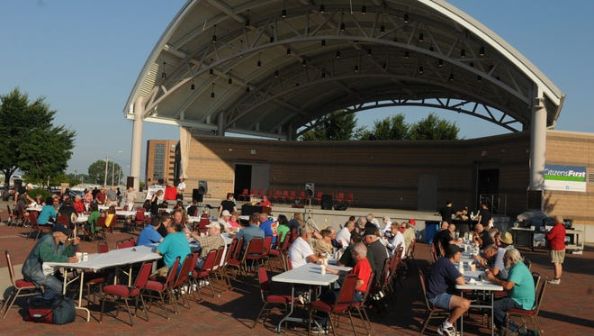 The Oshkosh Mayor's Breakfast was held Aug. 2, 2013, at  the Leach Amphitheater. Many people attended the event to have scrambled eggs and sausage and a drink.